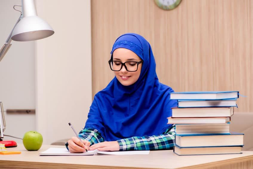 68764435 – muslim girl preparing for entry exams